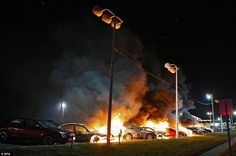 Destroyed: Cars burn at a car dealership as demonstrators protest the Grand Jury decision ...