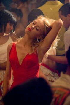 Amber Heard in The Rum Diary. Her in that red dress dancing in this scene is a vision imprinted on my mind. Just beautiful.