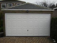 Hormann Double Up and Over Garage Door in White, Installed By ABi Garage Doors.