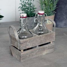 Mediterranean style glass bottles, complete with a wooden washed ash crate and leather handles.