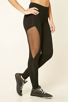 A pair of knit athletic leggings featuring a mesh panel, stitched style lines, and an elasticized waist.