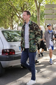 Men's street style | Military Style - Military jackets are a statement piece that can spice up any outfit. Wear yours with a pair of navy chinos and white trainers. | Shop the look at The Idle Man