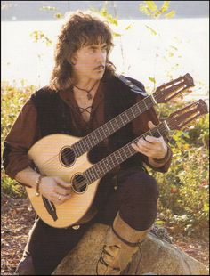 Ritchie Blackmore with double neck Fylde lute shaped guitar.