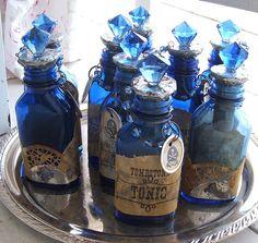 Blue Altered Art Bottles by Red Rock Rose Potion Bottle, Diy Bottle, Blue Bottle, Wine Bottle Crafts, Jar Crafts, Bottle Art, Altered Bottles, Vintage Bottles, Bottles And Jars