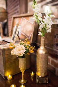 #gold wedding idea - bottles and champagne flutes - photo by Izzy Hudgins - http://ruffledblog.com/glitzy-bohemian-ny-wedding/ #Centerpieces #Gold