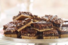 Make this recipe for over-the-top scrumptious Chocolate-Pecan Pie Bars! Serve and wow a whole crowd with these unbelievably tasty pecan pie bars.