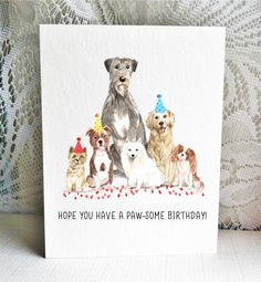 Available on Etsy, featuring a Cairn Terrier, Staffordshire Terrier / Pitbull, Irish Wolfhound, Japanese Spitz, Golden Retriever, and Ruby & White Cavalier King Charles Spaniel dogs. By Driven to Ink.