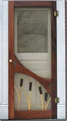Cat Tails On A Beautiful Wood Screen Door.