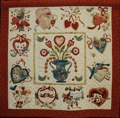 """1001-VintageValentine.jpg - 1001Elaine Bishop - Vintage Valentine (reduced size) -- Appliquéd Quilt - 2 or more persons. Exhibit Only. 45x45"""". Hand Appliquéd, 2010. Machine quilted by Cristyn Merry. Vintage Valentine Quilt Pattern, by Verna Mosquera. The backing fabric was the design source for the colors used in the top. The patterns were reduced so the finished quilt would be smaller and easier to hang on a wall."""