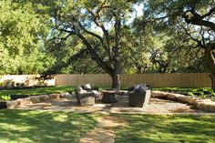 Backyard sitting area, oak tree canopy, flagstone patio. Reserve At Old Fredericksburg Model Part 2 Theraggedwren.blogspot.com