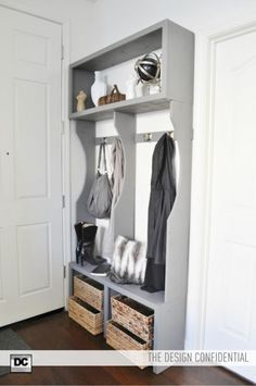 narrow entryway - one side to have hooks for coats, sweaters, and purses and the other side for a chalkboard and a raised shelf for setting iPad, keys, and change. (top shelf is ideal for storing jason's hat collection); use dvd baskets for shoe storage underneath; on the side, set a big handmade ceramic pot for umbrellas