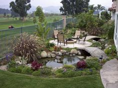 "charming ""island"" patio surrounded by a water feature and arched bridges.- Destination Decks and Patios on HGTV"