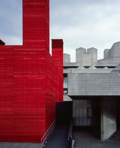 HAWORTH TOMPKINS, THE SHED THEATRE SOUTH BANK LONDON: a year-long, temporary venue for the national theatre; built with recyclable parts and fitted with re-used seating. also: it's bright red. <3