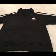 Adidas Child's Jacket Black/White Adidas Jacket with logo on front. Larger logo on the back. White stripes on both arms, zipper closure in front. ** Infant size {24} months. Adorable.. Adidas Jackets & Coats