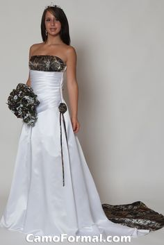 All white gown with camo accents, camo flower on the hip and hunters orange lace up back