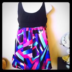 Forever 21 tank The black part is cotton and the pattern is more of a silk material. It also has belt loops. Forever 21 Tops Tank Tops