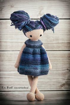 This is the downloadable crochet doll pattern. It contains instructions for make the doll and her wardrobe (dress, shoes, t-shirt, jacket and pants). The doll is designed to change her clothes and hairstyles.  The pattern is in PDF file with 15 pages of instructions and photos. The pattern is avaiable in two languages - English (using US terminology) and Polish. Size of the doll: 48cm from the top of the head to the feet using 75m/50g cotton and wool yarn and 4.0mm (US 6) crochet hook…
