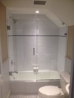 Custom wall to glass hinged shower door with side panel and clips by www.glassworksvt.com