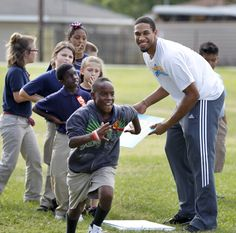 Xavier Henry of New Orleans Hornets spends time with students from Estelle Elementary for a Bee-Fit Field Day.