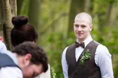 The groom sees his beautiful bride for the first time that day at their wedding in the bluebell woods at Jimmy's Farm, Suffolk. www.headoverheelsphotography.co.uk