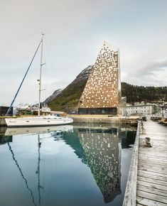 the internal programs including a climbing wall, auditorium and exhibition spaces have shaped the characteristic form of the harbor-side facility.