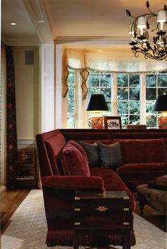 Living Room - Benson Interiors  Boston, Ma  www.bensoninteriors.com #livingroom #interiordesign #red #sectional #sidetable #chandelier #windowtreatments #lamps #woodtrim #carpet #woodfloors #ottoman #pillows