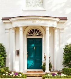 A colonial home adds a punch of color with Benjamin Moore's Peacock Blue paint.