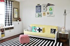 Find a futon for the reading nook. Super cute and functional for when we watch  kids' movies in the studio.