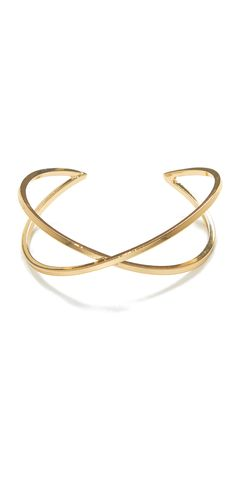 Try this sleek cuff from Jeweliq.com for a minimal approach to a contemporary arm party!