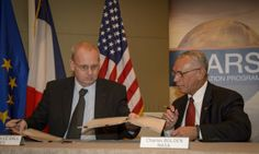 NASA Administrator Charles Bolden, right, and Jean-Yves Le Gall, president of the National Center of Space Studies of France (CNES), sign an...