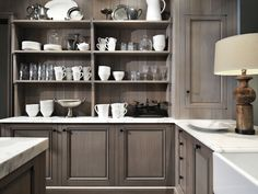 Love the color and finish for the cabinets combined with the white surface.