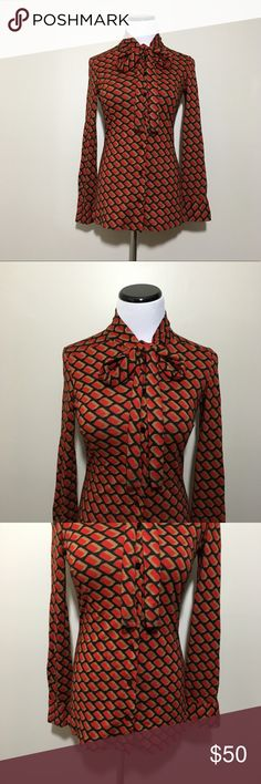 Vintage Diane Von Furstenberg Geometric Bow Top Geometric bow button down Top by Diane Von Furstenberg. Vintage from the late 60's or early 70's. Bow at the neck that can be tied or left undone. Black with red and tan. Colors can appear lighter or darker depending on the lighting. Great vintage condition. No rips or stains.  Measurements (approximate, taken laying flat): Underarm to underarm: 15.5 inches Length: 25 inches  Material: 100% acrylic  ❌No trades❌ Diane Von Furstenberg Tops Button…