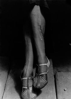 Dorothea Lange, a sign of the times - depression,  mended stockings, San Francisco, 1934.