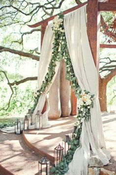 I know this was probably designed for an outdoor wedding, but I just think it's so beautiful. I'd love something like this in my backyard with a two-person hammock and a fire pit. Mmmm...yes.