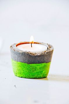 http://www.ireado.com/make-your-own-cheap-candle-holders-with-diy-concept/ Make Your Own Cheap Candle Holders With DIY Concept : Colorful Concrete Candle Cheap Candle Holders