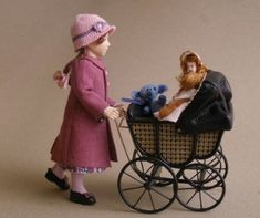 Marie France Beglan doll with pram  I have wanted one of Marie France Beglan's dolls forever!  One day I'll finish up my dolls house for one or two to live in.  :)