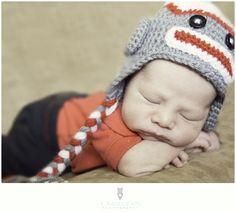 Newborn photography. Love yge sock monkey hat.