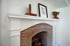 Not necessarily like htis but I want a fireplace with white in the living room but I love a brick fireplace too... So both?
