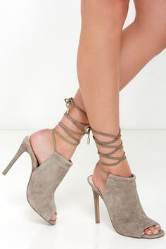 """If you've been adoring all the amazing leg wrap looks out there, you'll love the Steve Madden Sophie Taupe Suede Leather Leg Wrap Heels! The softest suede shapes a peep-toe upper with a slide-in mule design, and long suede laces that wrap several times around the calf. 4.25"""" wrapped stiletto heel. Cushioned insole. Rubber sole has nonskid markings. Available in whole and half sizes. Measurements are for a size 6. Leather upper. Balance man made materials. Imported."""