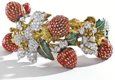 GOLD,  PLATINUM,  DIAMOND,  CORAL  AND  ENAMEL  STRAWBERRY  BRACELET,  DONALD  CLAFLIN  FOR  TIFFANY  &  CO.,  CIRCA  1970. Sotheby's.