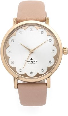 Crystal markers and scalloped detailing give this Kate Spade New York watch a feminine look. Leather band. Adjustable length and buckle closure. <ul> <li>Water resistant to 50 meters.</li> <li>2-year manufacturer warranty.</li> <li>Imported, China.</li> <li>Measurements</li> <li>Dial: 1.25in / 3cm</li> <li>Band: 0.5in / 1.25cm</li> <li>Length: 6-7.5in / 15-19cm A manufacturer's warran