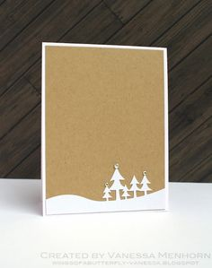 Simple snowy tree outline Christmas card from wings of a butterfly