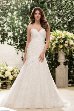 Strapless Wedding Dresses | Jasmine Bridal F181052 | Gateway Bridal & Prom | SLC Utah Bridal Shop | Worldwide Shipping | Fit and flare gown with flattering Chantilly Lace pleating and sparkling sequin lace featuring a sweetheart neckline and assymetrical bodice that is great for all shapes and sizes! We suggest to add a beaded belt to dazzle your wedding guests! |     Gown available in Gold/Ivory, Ivory or White    *Gown pictured in Gold/Ivory