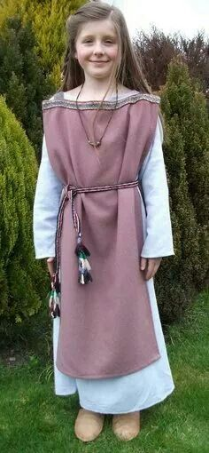 Easy medieval dress, essentially 2 rectangular pieces of material joined with braiding