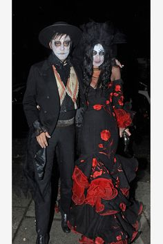 Kate Moss and her husband dress as an undead couple in Spanish Flamenco attire at Jonathan Ross's Halloween party in London.