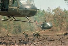 A helicopter hovers over the field, ready to load personnel and equipment during Operation Masher in the Vietnam War, May 7, 1966.  (AP Photo)