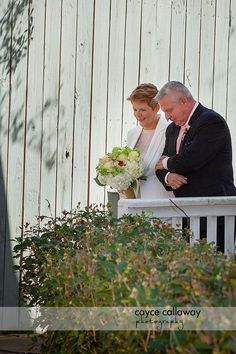 A bride and her father walk down the aisle outside at Payne Corley House, Atlanta GA