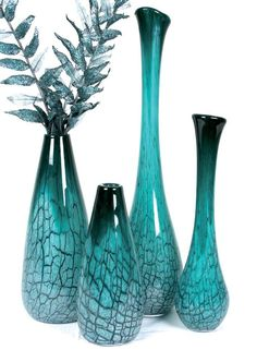 teal vases look great they could be a small detail or an accent to a room...lovely