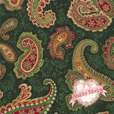 "Holiday Flourish 6 AEBM-13644-224 Evergreen By Elizabeth Brownd For Robert Kaufman Fabrics: Holiday Flourish 6 is a collection by Elizabeth Brownd for Robert Kaufman Fabrics.  100% cotton.  43/44"" wide.  This fabric features a large red and green paisley with gold metallic accents on a green background."