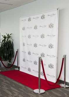 Step and Repeat Backdrop - Custom Monograms, Company Logos, Sponsor Logos, etc. Add Red Carpet and Rope for an extra special experience in Grand Rapids, MI!